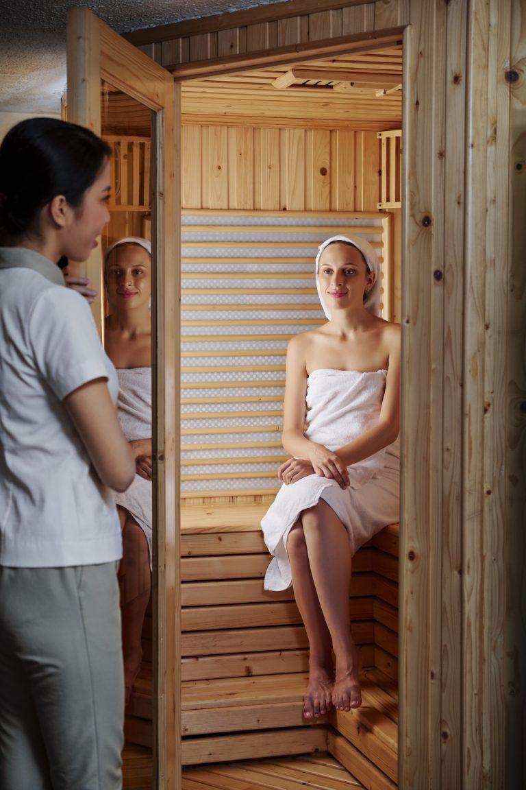 Enjoying sauna in spa salon